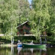 Wooden cottage in Finland — Stock Photo #11100434