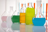 Laboratory glass containing liquid color — Stock Photo