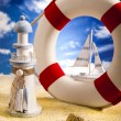 Life buoy on the beach - Stock Photo