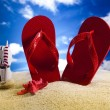 Flip flops on the beach — Stockfoto