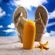 Suntan oil on beach - Stock Photo
