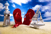 Flip flops and sand — Stock Photo