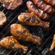 Foto de Stock  : Grilling meat in flames, tasty dinner