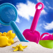 Colorful plastic toys on the beach — Stock Photo
