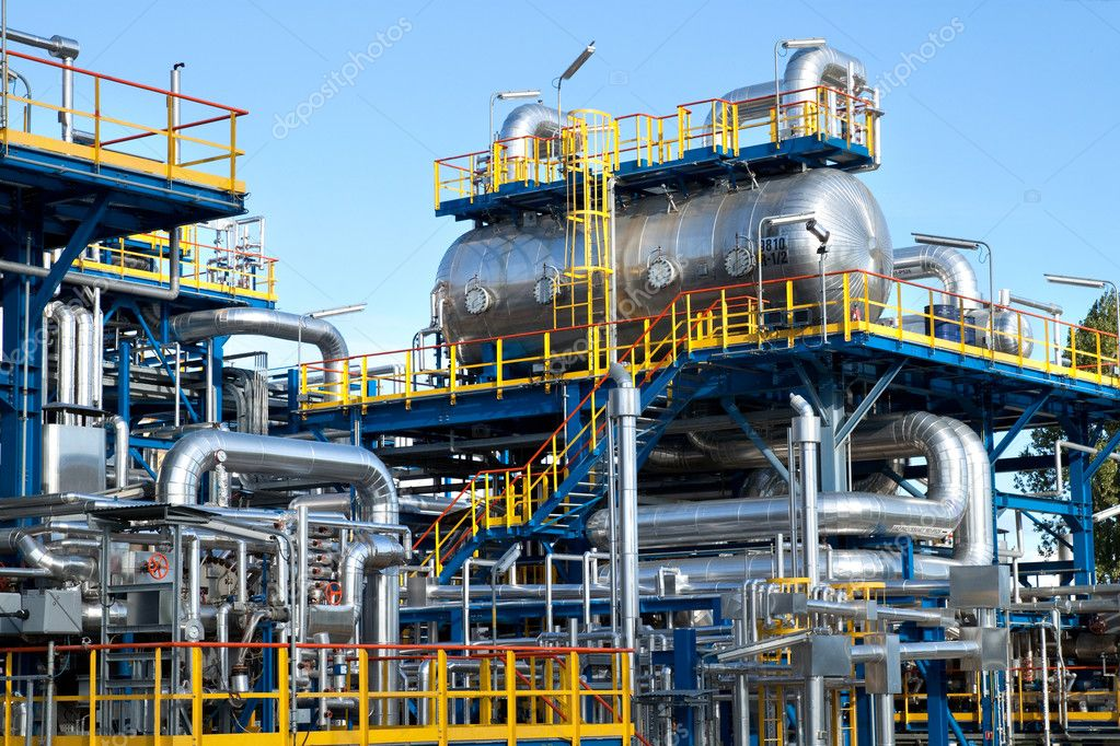 Oil industry equipment installation, metal pipes and tanks — Stock Photo #11460063