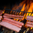 Stock Photo: Brats cooking on gril