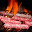 Stock Photo: Brats cooking on grill