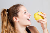 Portrait of woman with apple — Stock Photo
