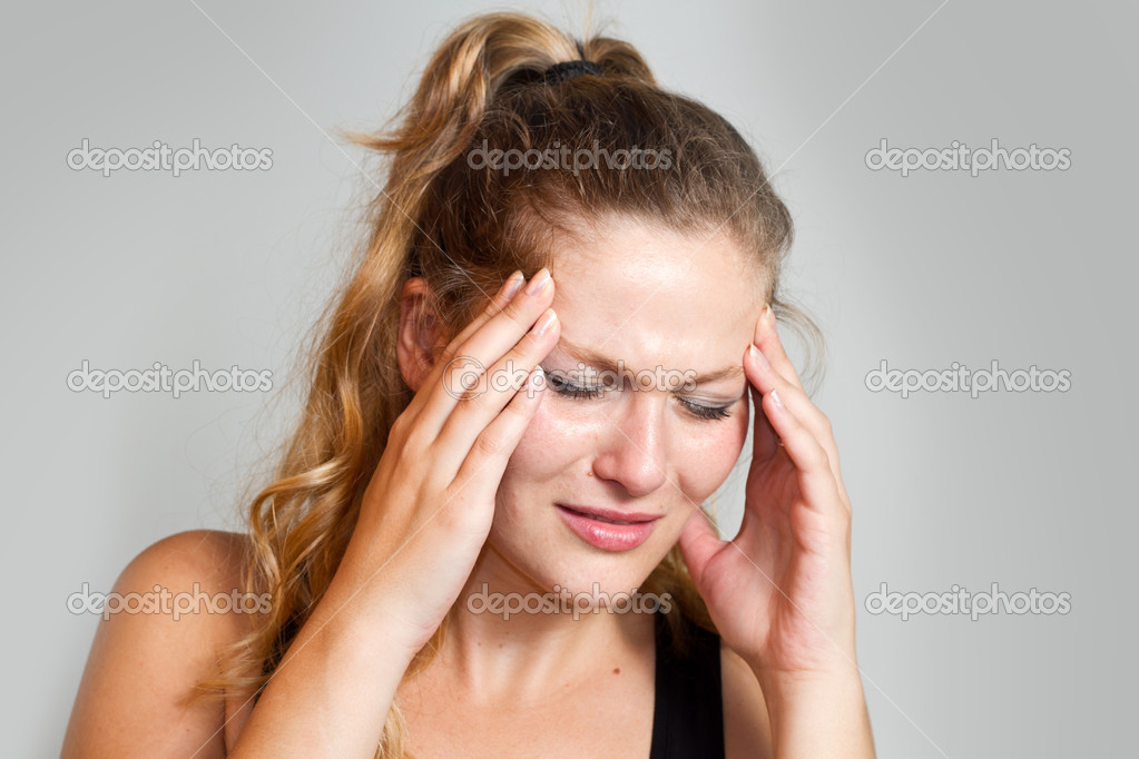 Portrait of a caucasian woman with headache — Stock Photo #11036879