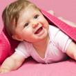 An adorable, laughing baby looking at camera — Stock Photo