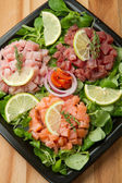 Salmon, tuna and swordfish tartare — Stock Photo