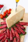 Italian appetizer with bresaola and parmesan cheese — Stock Photo