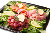 Salmon, tuna and swordfish tartare — Stock Photo