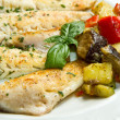 Fish fillet with vegetables - Stock Photo