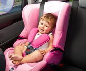 Baby in a safety car seat. Safety and security — Stockfoto