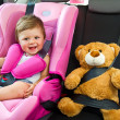 Baby girl smile in car - Foto Stock