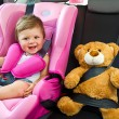 Baby girl smile in car - Stockfoto