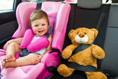 Baby girl smile in car — Stok fotoğraf