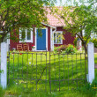 Entrance of red wooden cottage in Sweden - Stock Photo