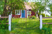 Entrance of red wooden cottage in Sweden — Stock Photo