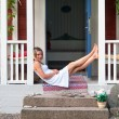 Attractive woman sitting on a veranda — Stock Photo