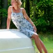 Attractive woman reclining on a boat hull - Stock Photo