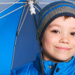 Stock Photo: Boy with umbrella
