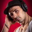 DJ in front of a red Background — Stock Photo