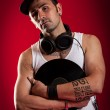DJ in front of a red Background — Stock Photo #10994715