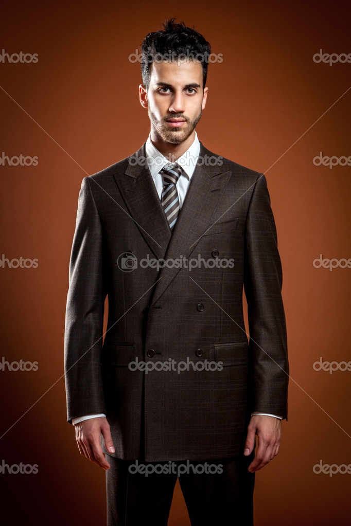 Photo of elegant businessman over brown background — Stock Photo #11682904
