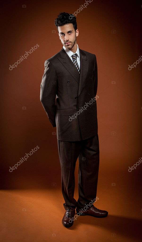Photo of elegant businessman over brown background — Stock Photo #11682925