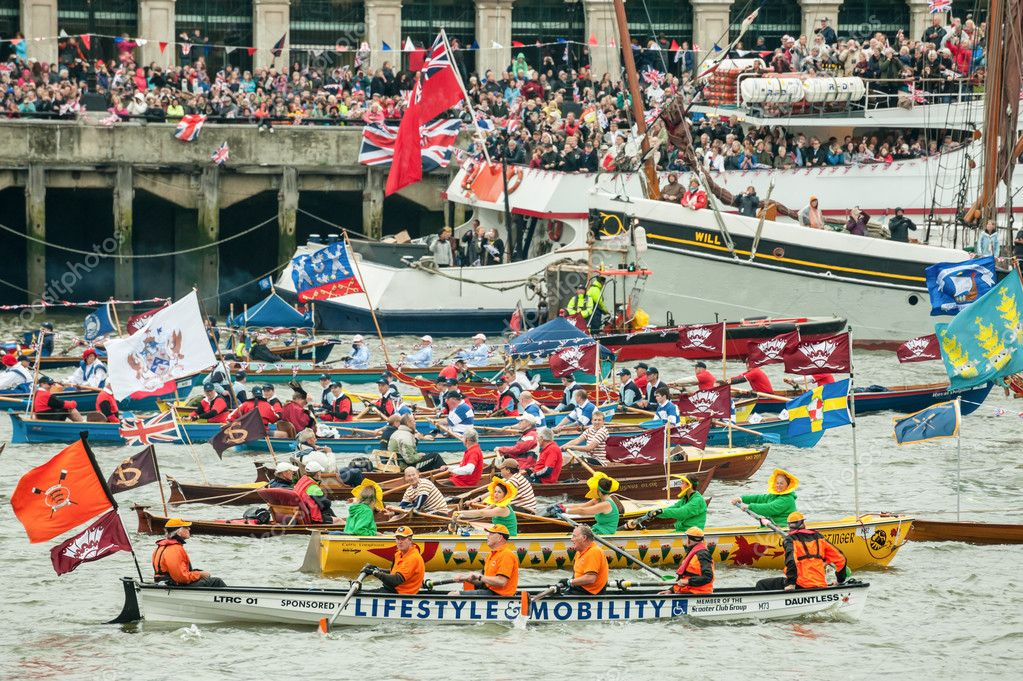 Colorful flotilla of rowing boats, part of the one thousand boat Queen Elizabeth II Diamond Jubilee Pageant on the River Thames, London, UK on June 3, 2012  Stock Photo #10980723