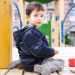 Boy sits on playground — Photo