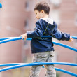 Boy standing on playground — 图库照片