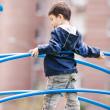 Boy standing on playground — Stock Photo