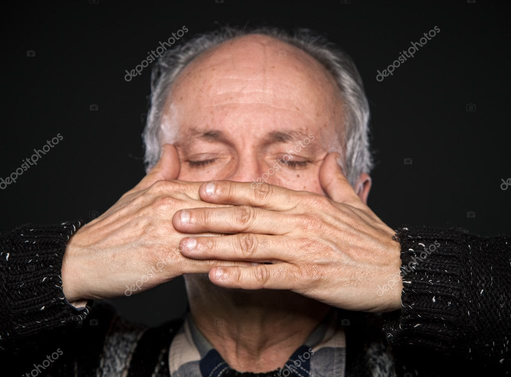 An elderly man with closed eyes closed mouth with hands. Focus on hands — Stock Photo #10830358