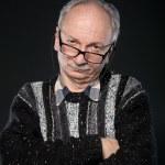 Elderly man looks skeptically — Stock Photo #10891669