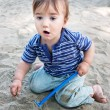 Cute kid playing with sand - Stock Photo