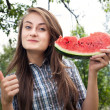 Woman and watermelon — Stockfoto