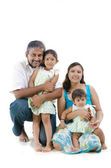 Happy Indian family sitting on white background — Stock Photo