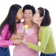 Daughters kissing to her mum. — Stock Photo