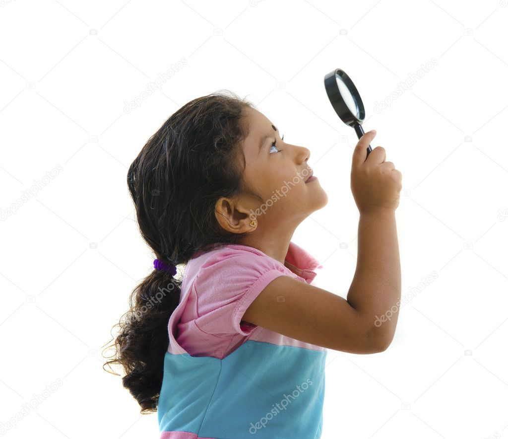 Indian girl with magnifying glass — Stock Photo #11585614