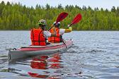 Canoe in white sea — Stock Photo