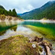 Lake in mountains, in a rainy day — Stock Photo