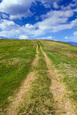 Dirt road in the mountains — Stock Photo