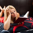 Sexy lady reading in bed — Stock Photo #11448437
