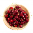 Cherries in a wooden bowl — Stock Photo