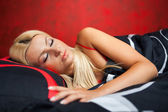 Young woman in bed in red underwear — Stock Photo