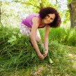 Young woman piling up mowed grass — Foto de Stock