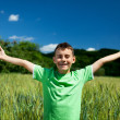 Happy boy in a wheat field — Stock Photo